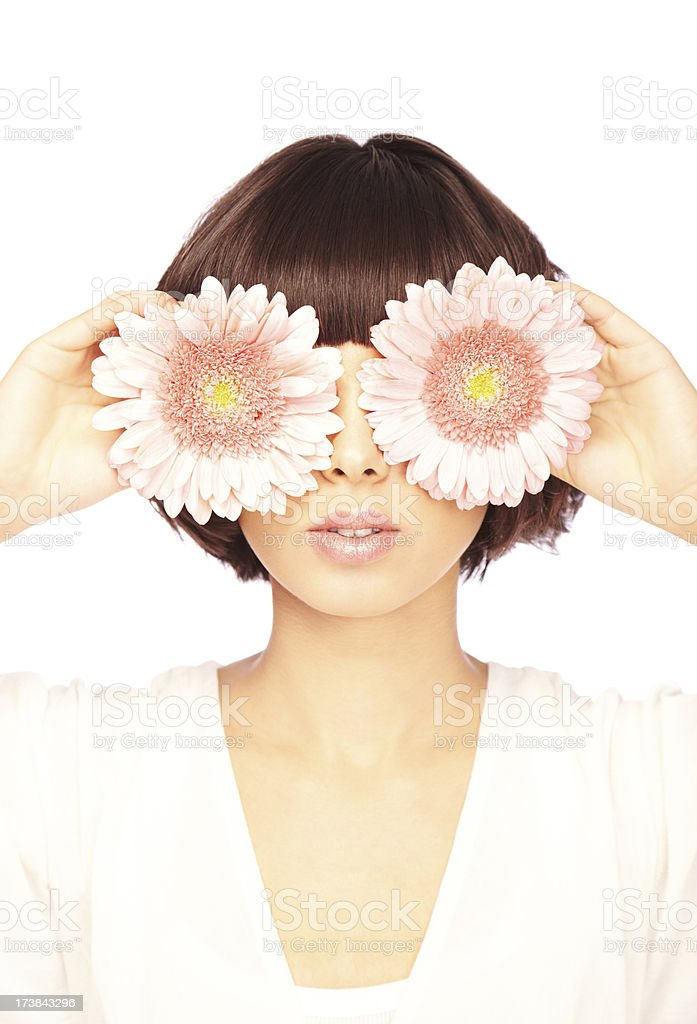 Brunette Covering Her Eyes with Gerbera Daisies royalty-free stock photo