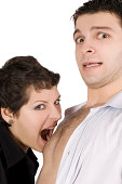 istock brunette embracing man and going to bite him 187405531