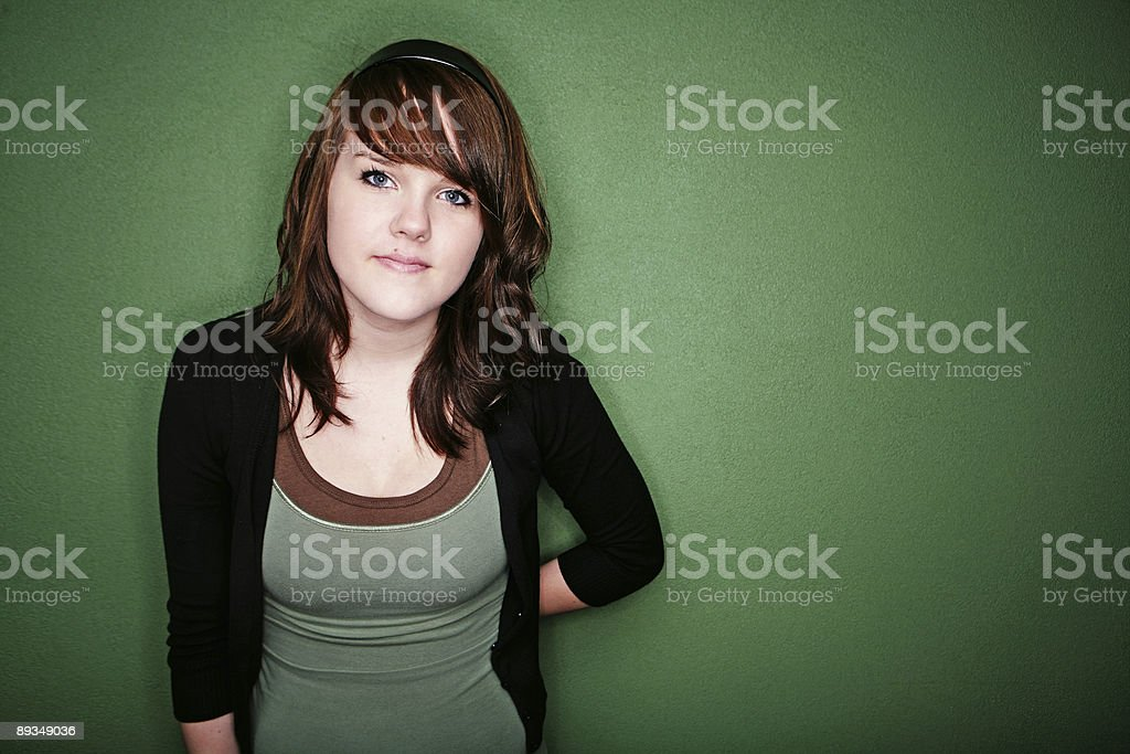 Brunette Female Against Green Wall royalty-free stock photo