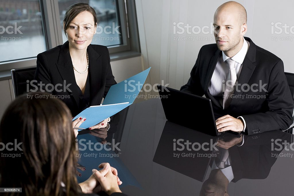 A brunette female participating in a job interview royalty-free stock photo