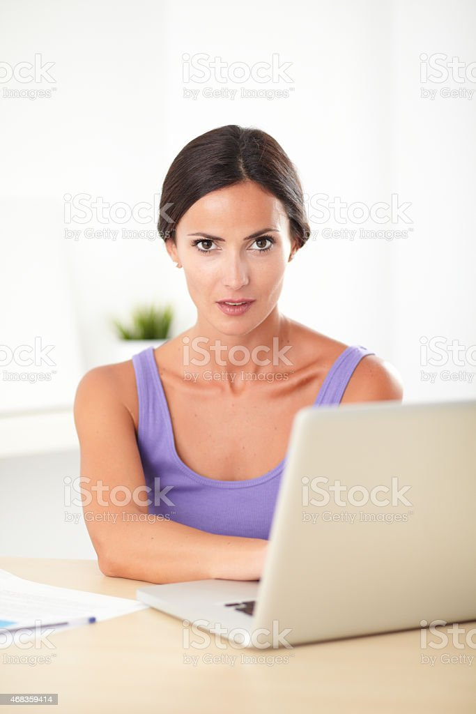 Brunette female working on the computer royalty-free stock photo