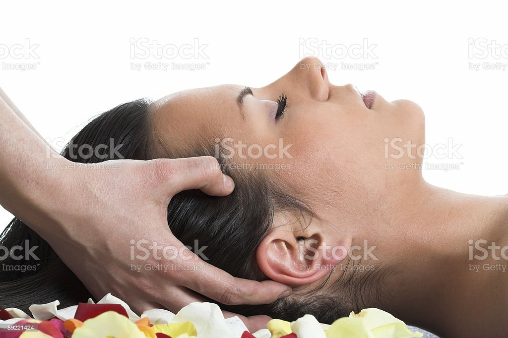 Brunette getting a head massage in the spa salon royalty-free stock photo