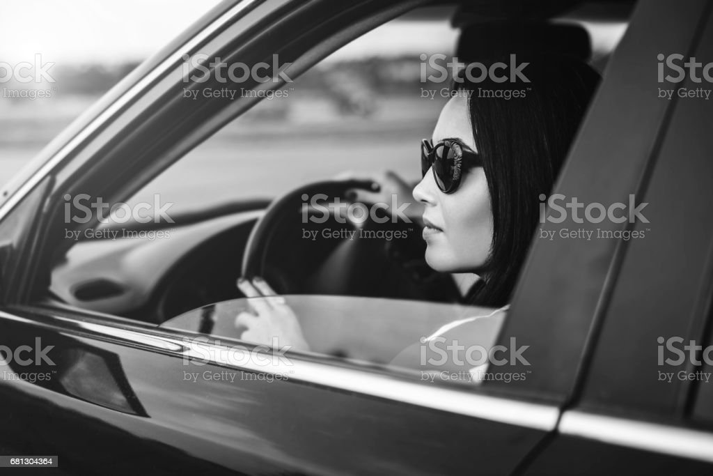 Brunette girl driving car on the road royalty-free stock photo