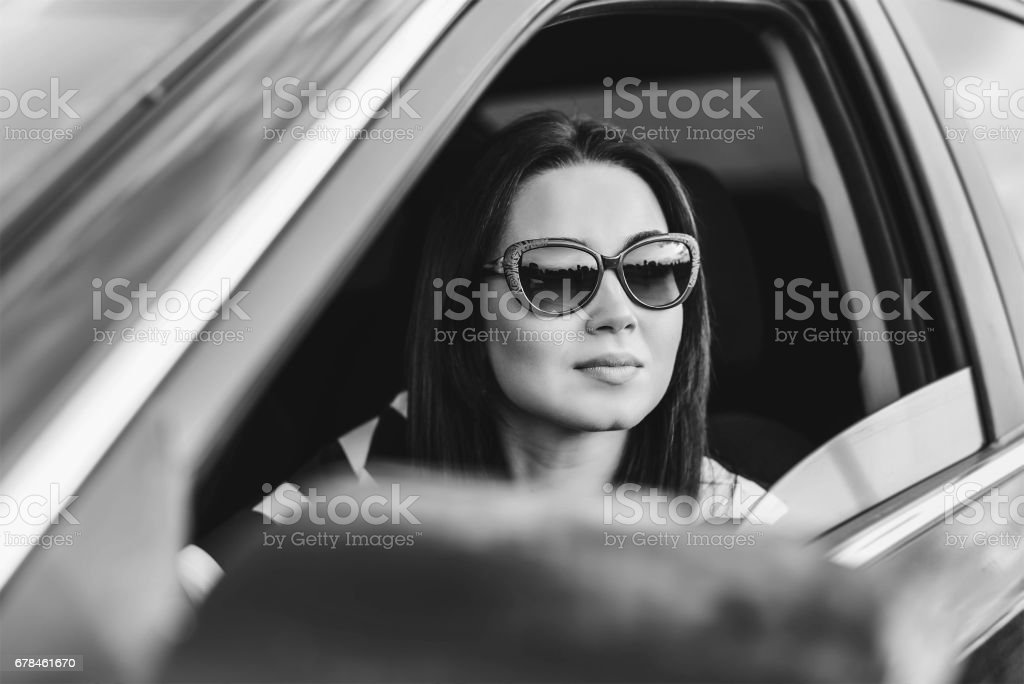 Brunette girl driving car royalty-free stock photo