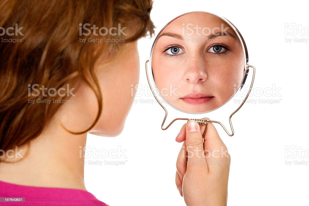 Brunette Girl From Behind  Looking Through Mirror at Viewer Isolated stock photo