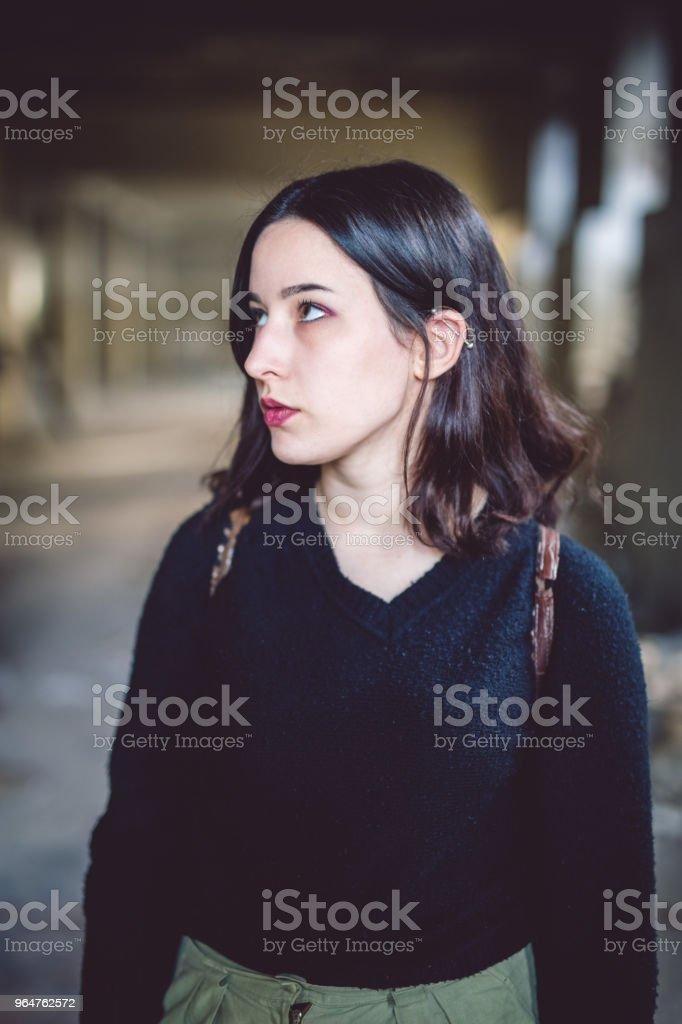 Brunette girl in a dark sweater royalty-free stock photo