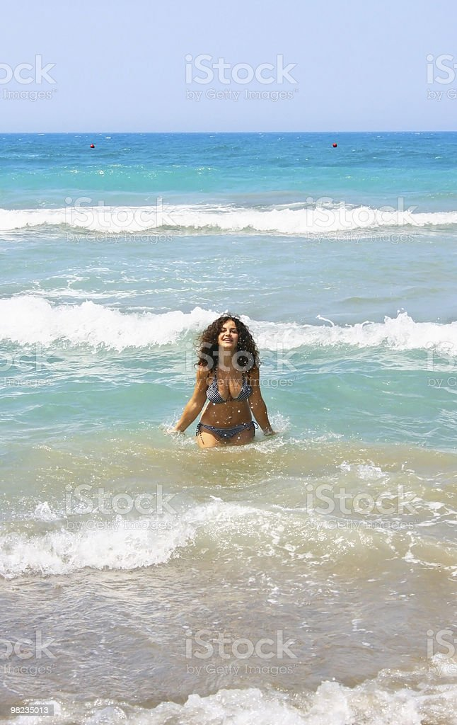 Brunette girl in the sea royalty-free stock photo