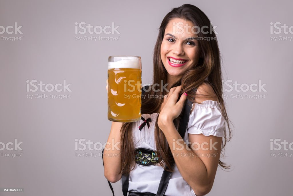 Brunette girl in traditional bavarian costume in Germany stock photo