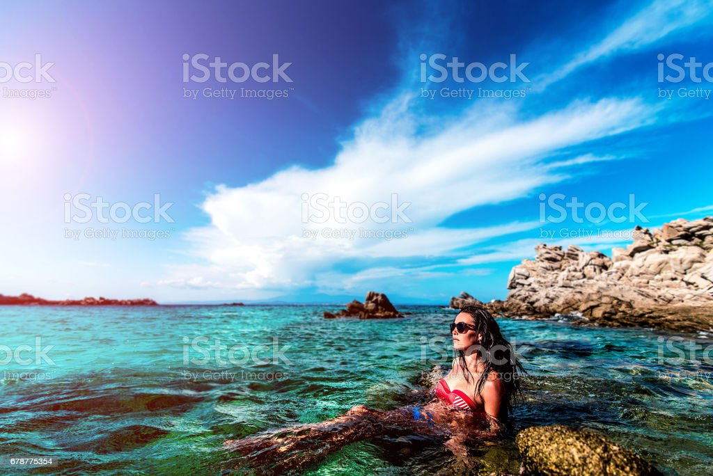 Brunette girl relaxing at the sea royalty-free stock photo