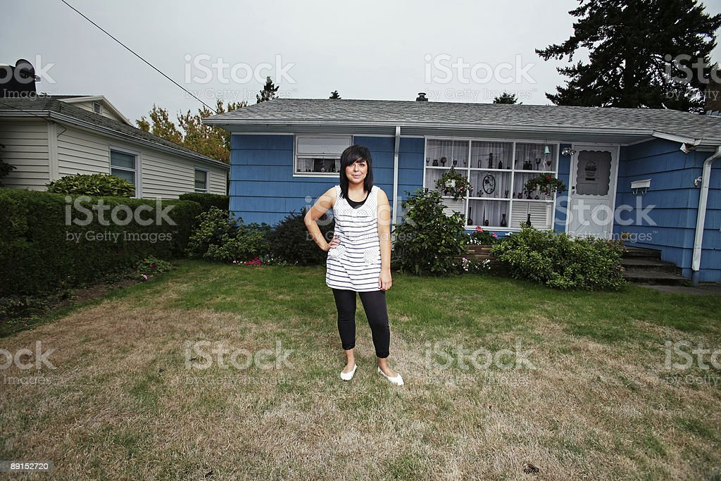 Brunette Girl Standing in Front Yard royalty-free stock photo