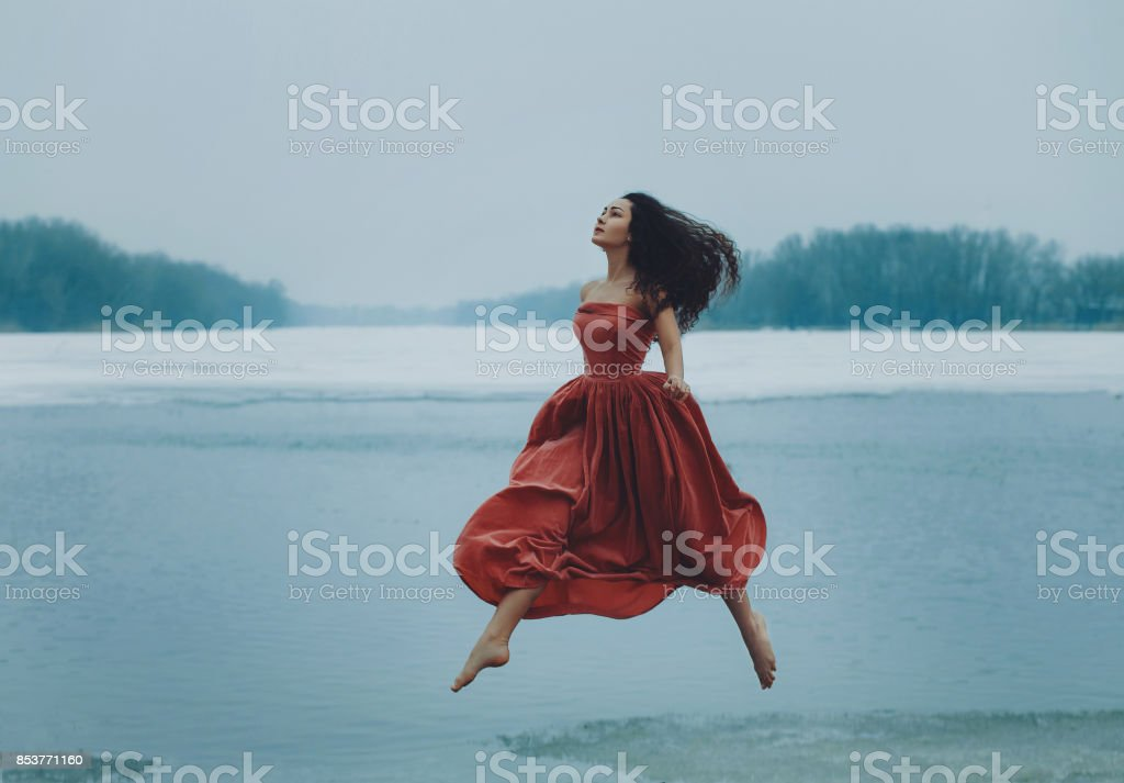 brunette girl  walking in the air stock photo