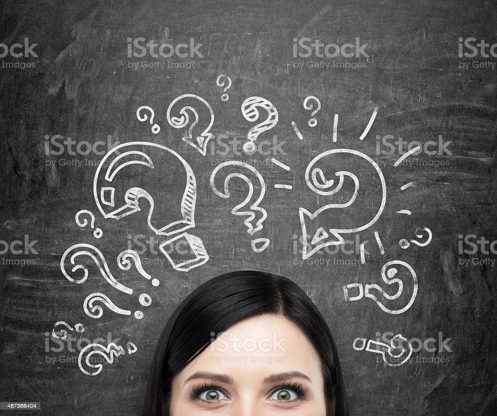 brunette girl who is pondering about unsolved problems stock photo