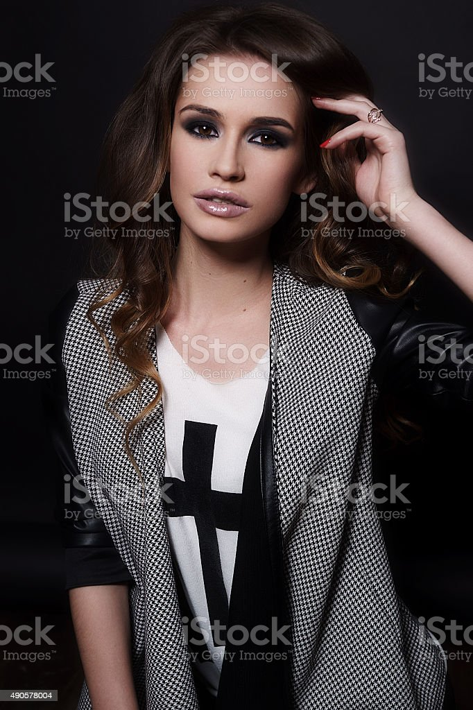 Brunette girl with high-fashion make-up in t-shirt and coat stock photo