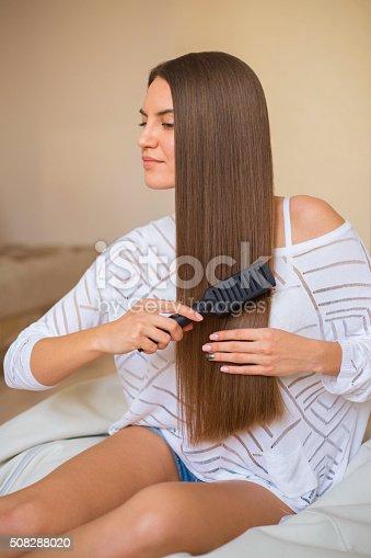 istock brunette girl with long hair 508288020
