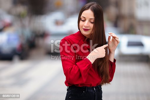 625205382 istock photo Brunette hair woman brushing her hair with brush and smiling 658910518