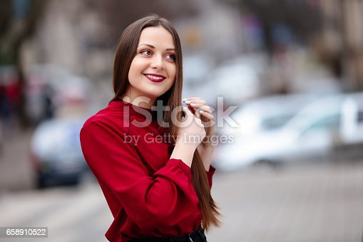 625205382 istock photo Brunette hair woman brushing her hair with brush and smiling 658910522