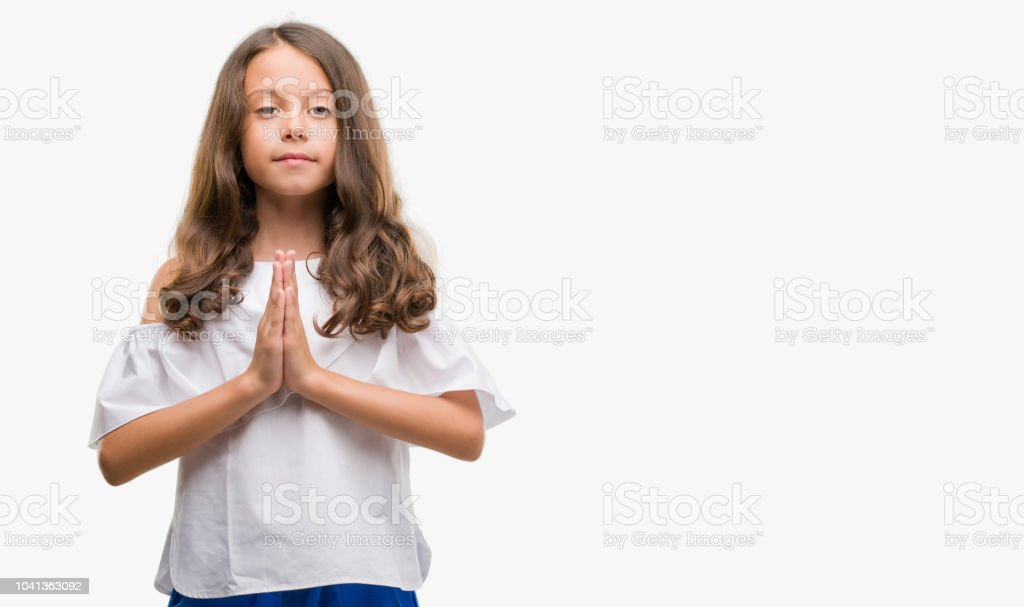Brunette Hispanic Girl Praying With Hands Together Asking For