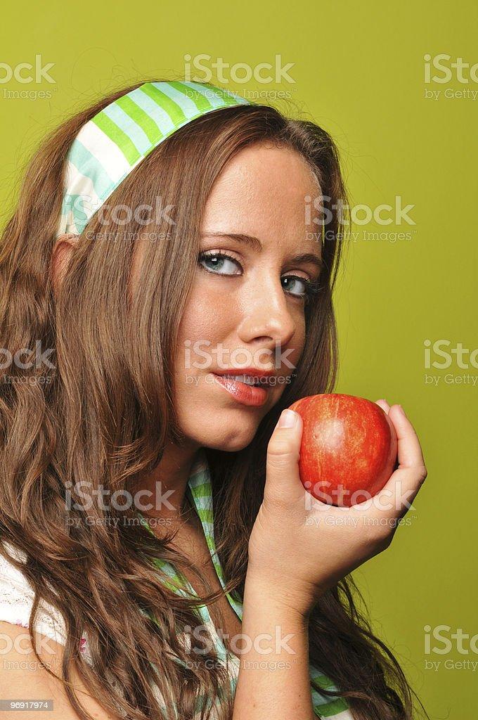 Brunette holding apple royalty-free stock photo
