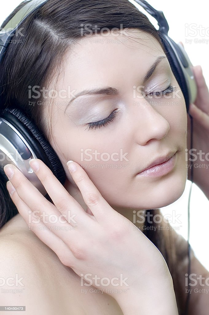 brunette in headphones listens to music royalty-free stock photo