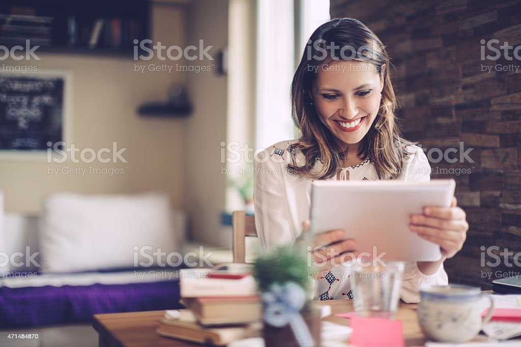 Brunette latin businesswoman working at home stock photo