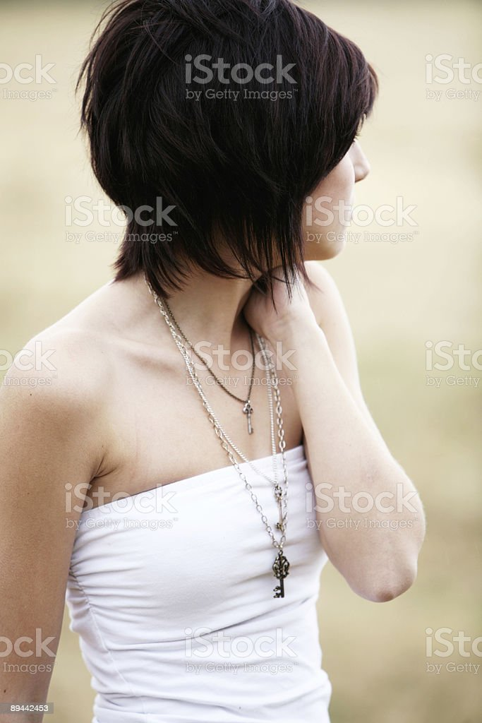 Brunette Looking off to a Dry Field royalty-free stock photo