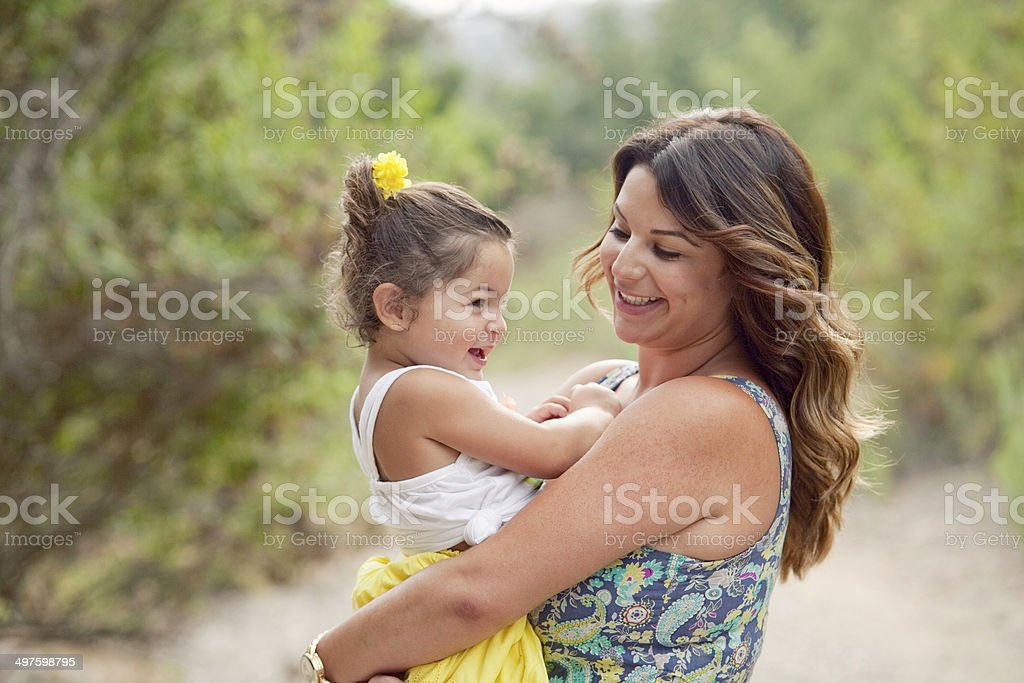Brunette mother and daughter laughing stock photo