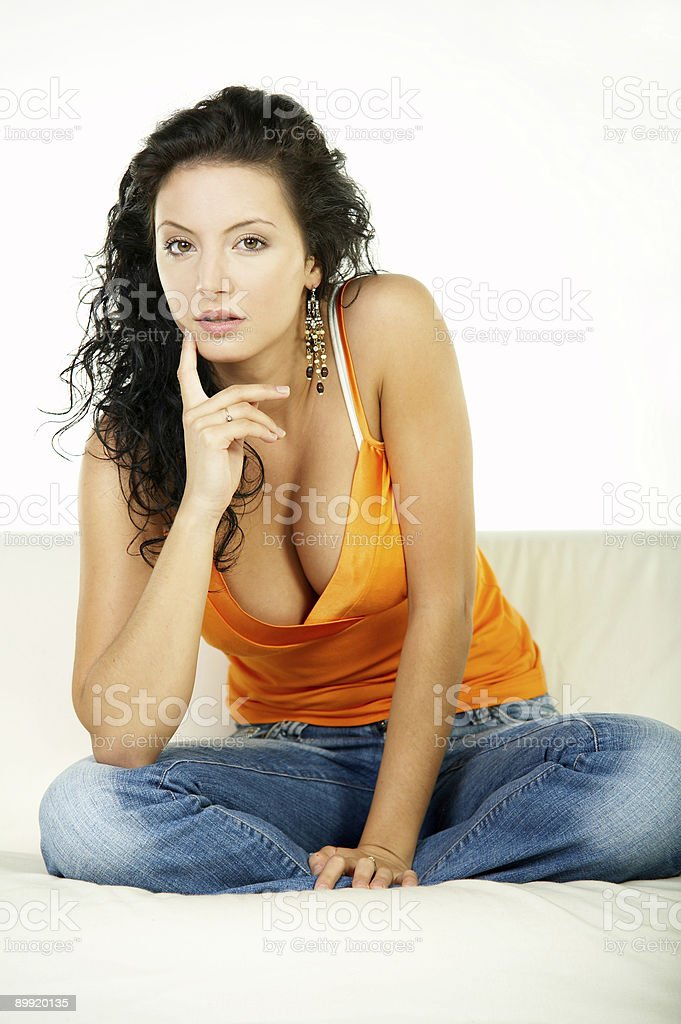 Brunette on couch royalty-free stock photo