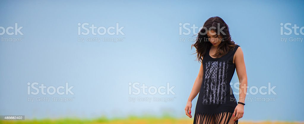 Brunette outdoors in the field stock photo