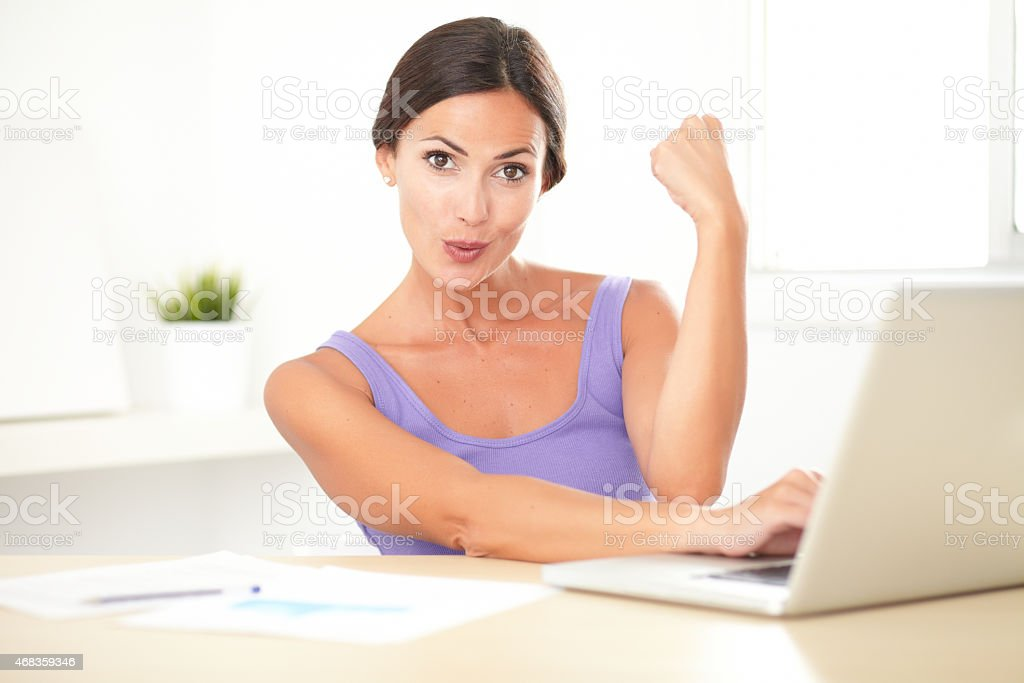 Brunette satisfied lady working on her computer royalty-free stock photo