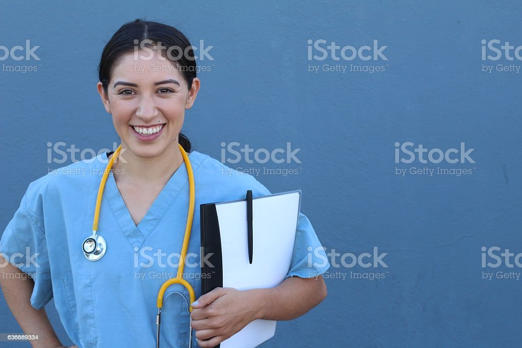 Brunette Spanish Doctor Woman With A Clipboard Stock Photo