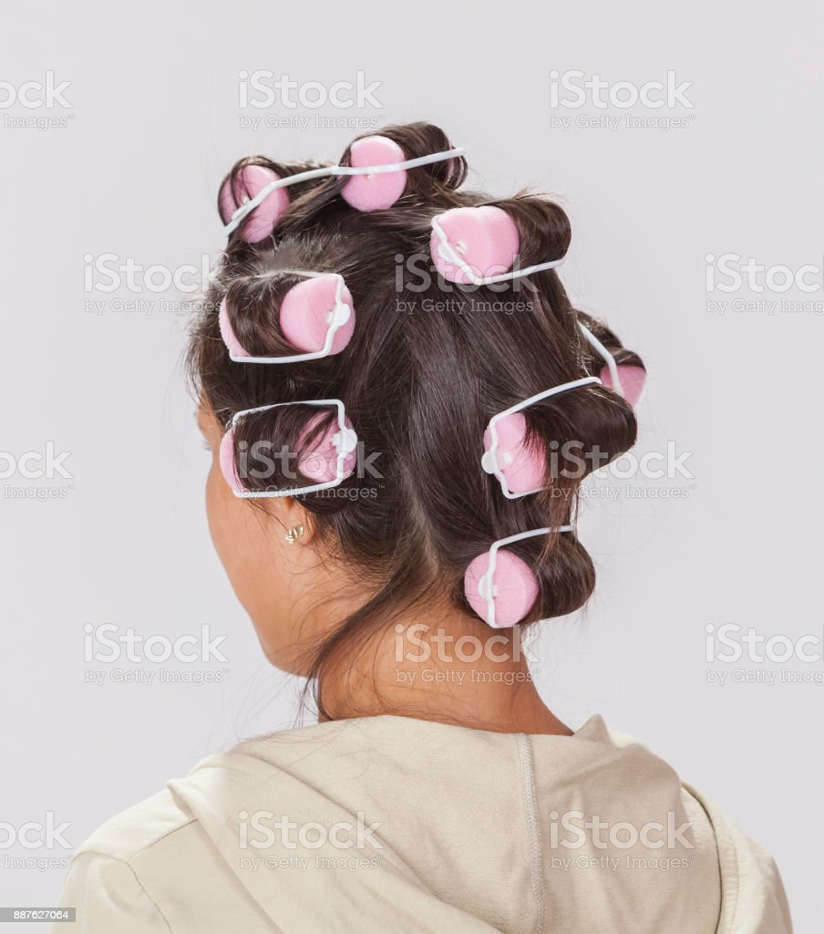 Brunette with Curlers stock photo