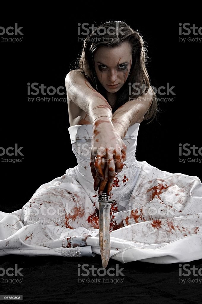brunette with knife stock photo