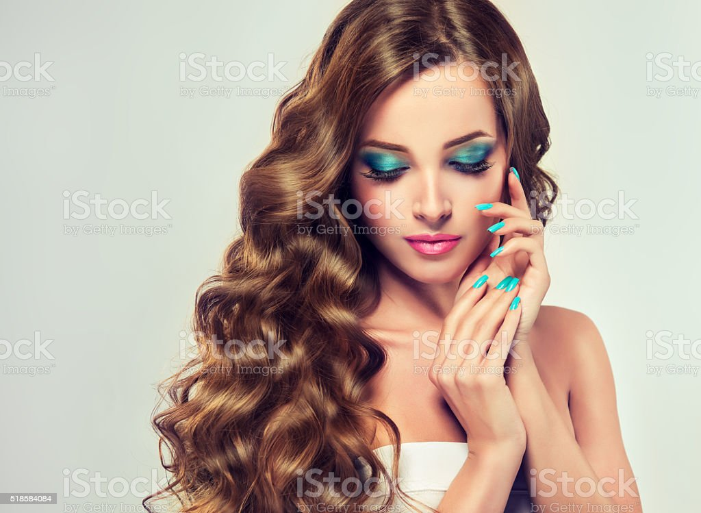 Brunette with long and lush curled hair. stock photo
