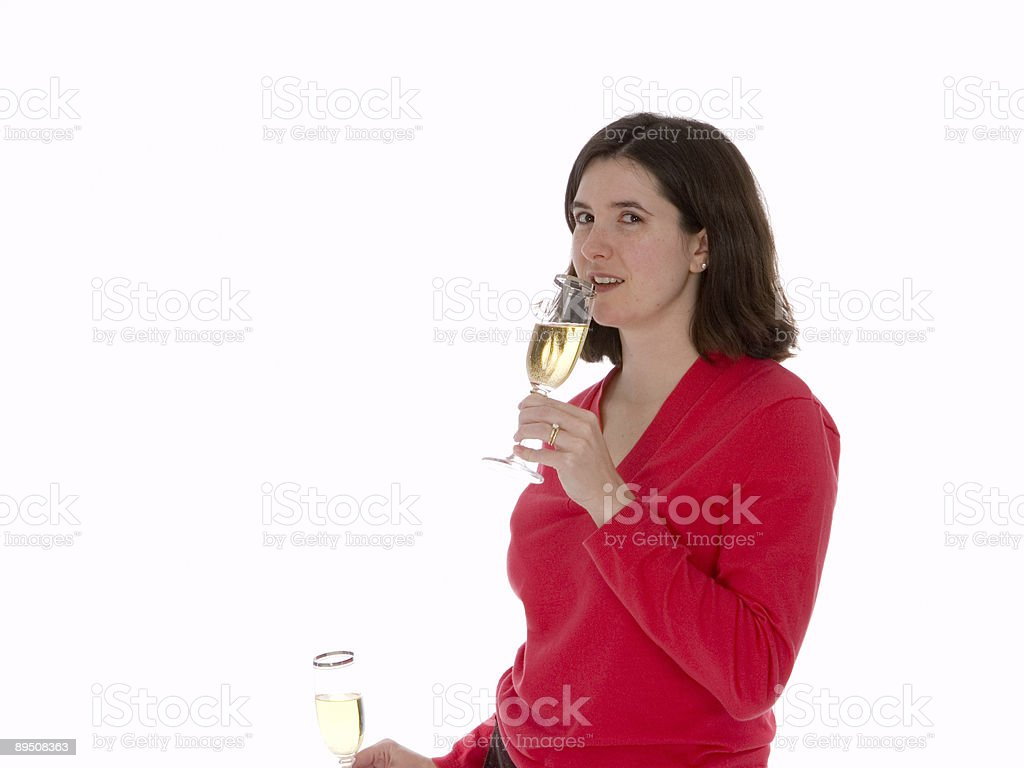 Brunette Womain in Red with Champagne Glasses royalty-free stock photo