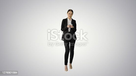 Wide shot. Front view. Brunette woman counting euro banknotes and looking to camera on gradient background. Professional shot in 4K resolution. 043. You can use it e.g. in your medical, commercial video, business, presentation, broadcast