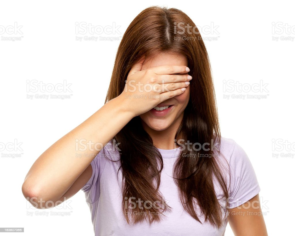Brunette woman covering eyes with hand royalty-free stock photo