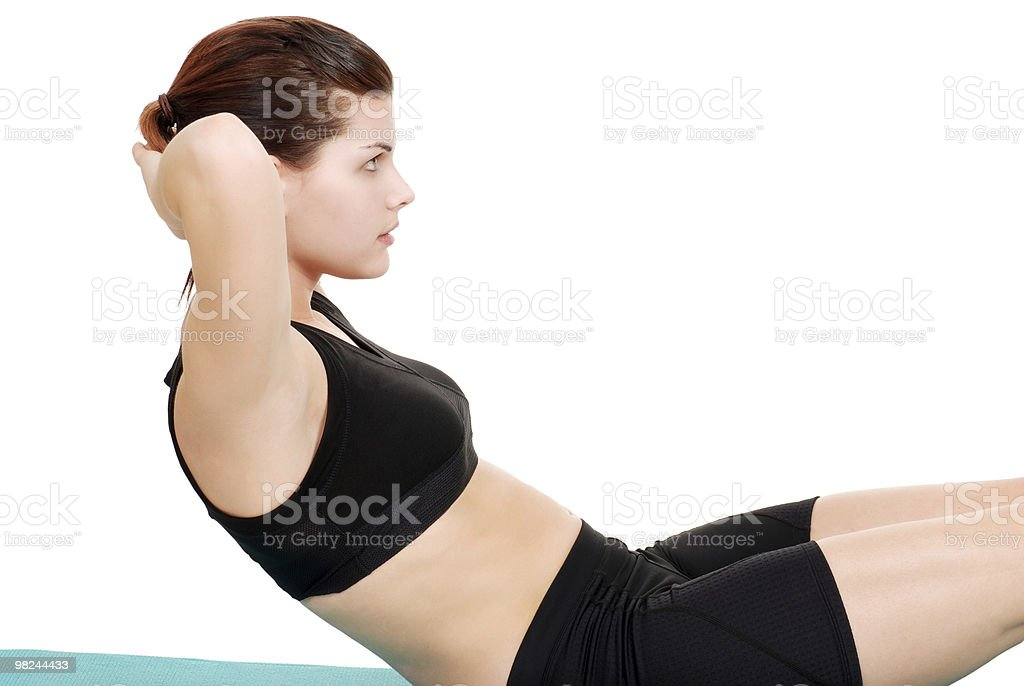brunette woman doing a sit up royalty-free stock photo