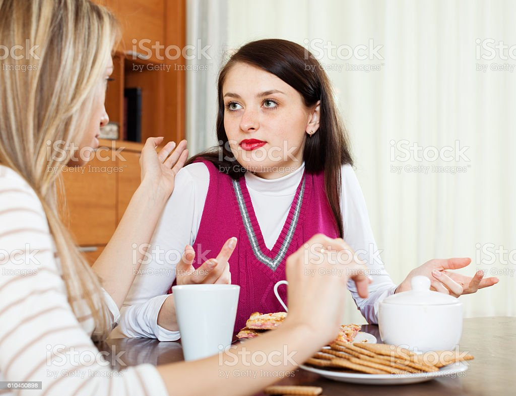 brunette woman has problem, girlfriend consoling her stock photo