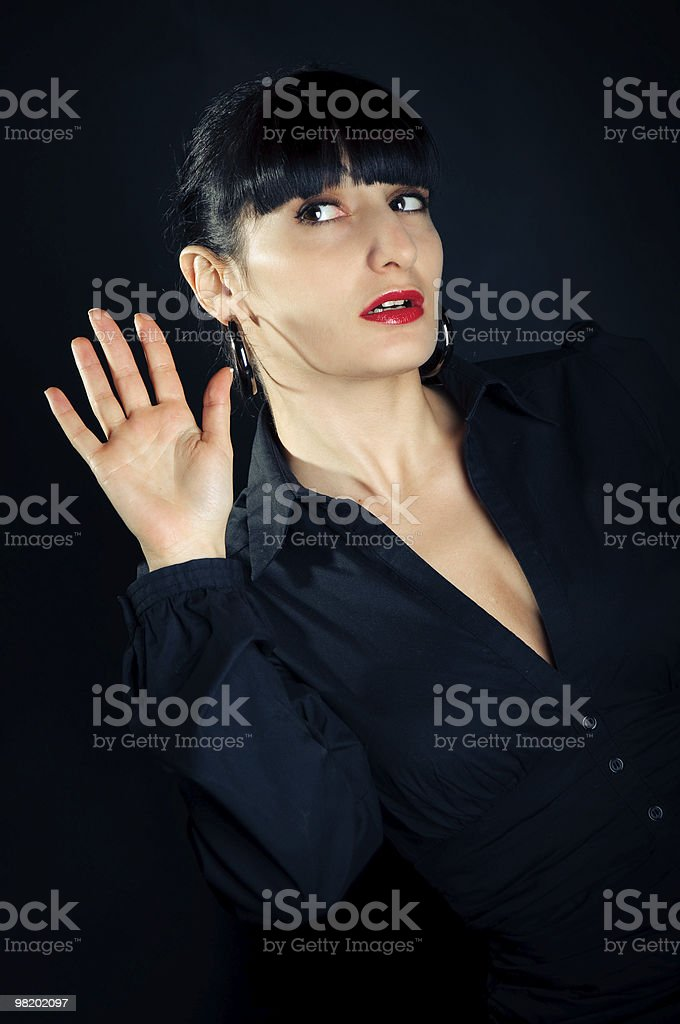 brunette woman in a dark clothes attentive listening royalty-free stock photo