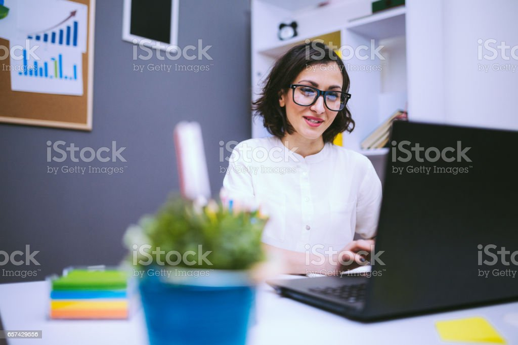 Brunette Woman In Eyeglasses Typing Report stock photo