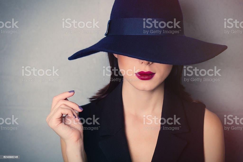 brunette woman in hat stock photo