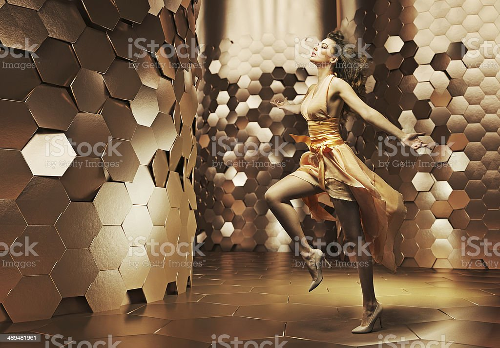 Brunette woman in the golden place stock photo
