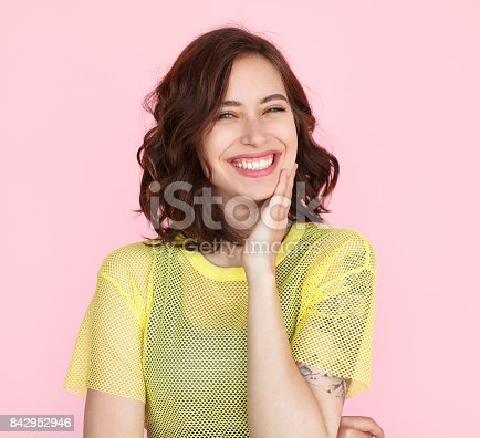 istock Brunette woman in yellow shirt smiling 842952946