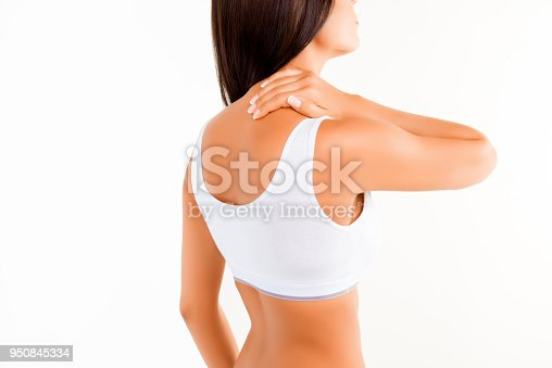 Brunette woman massaging her neck because it hurts