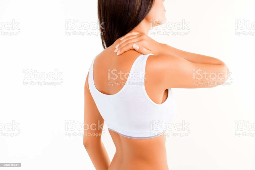 Brunette woman massaging her neck because it hurts stock photo