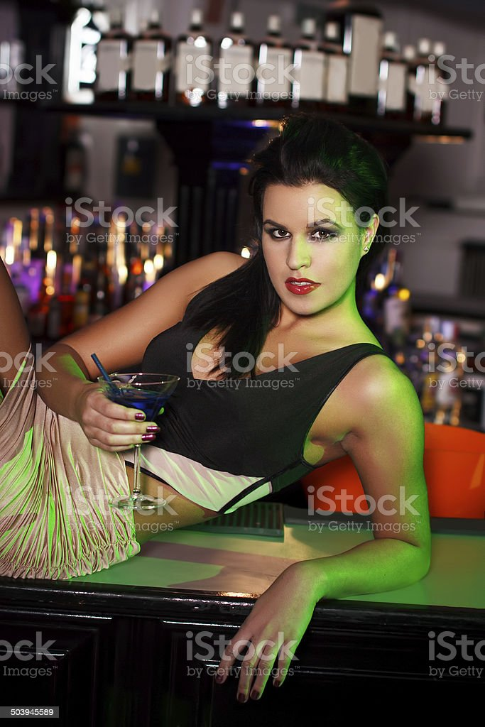 Brunette woman posing on table royalty-free stock photo