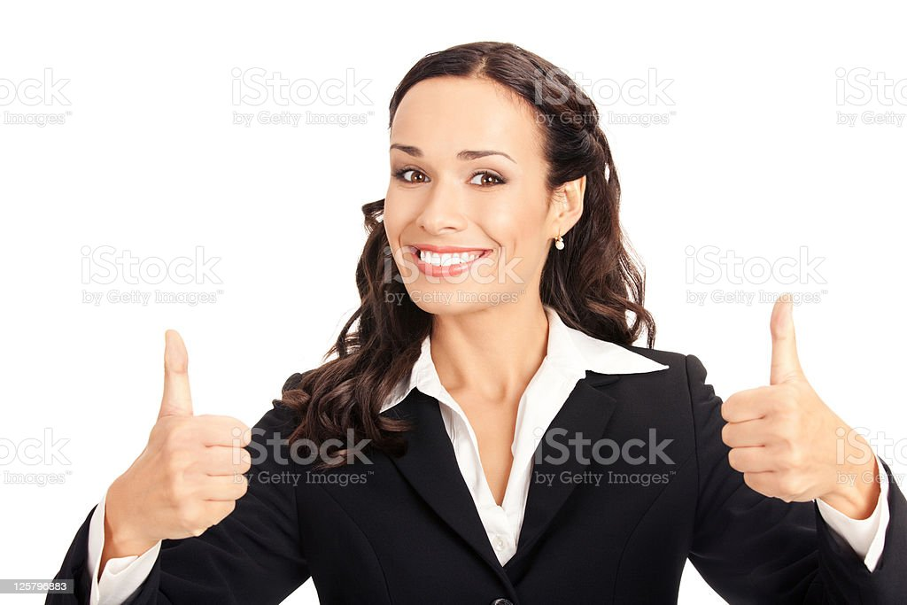 Brunette woman posing with thumbs up on white background stock photo