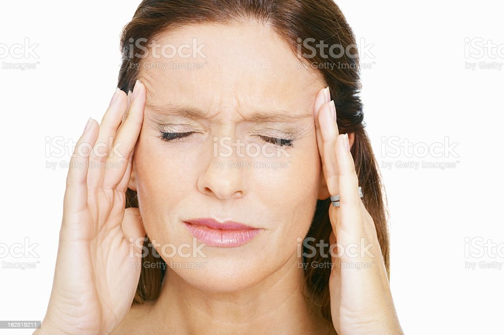 Brunette woman rubbing her temples to alleviate a headache royalty-free stock photo
