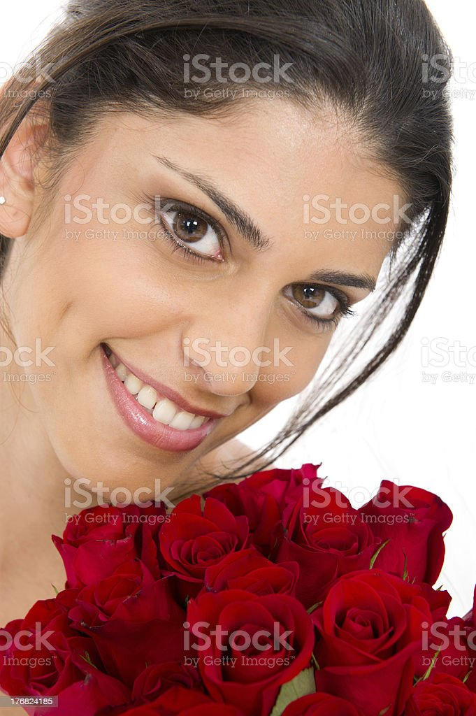 Brunette Woman Smiling and Holding a Dozen Red Roses royalty-free stock photo