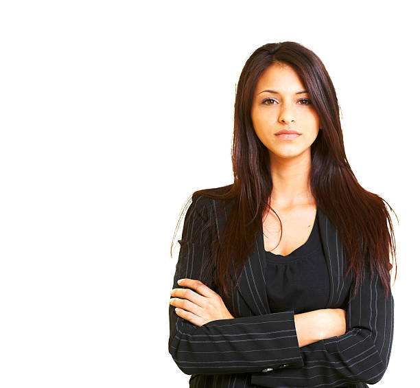 Brunette woman wearing black suit jacket with arms crossed stock photo